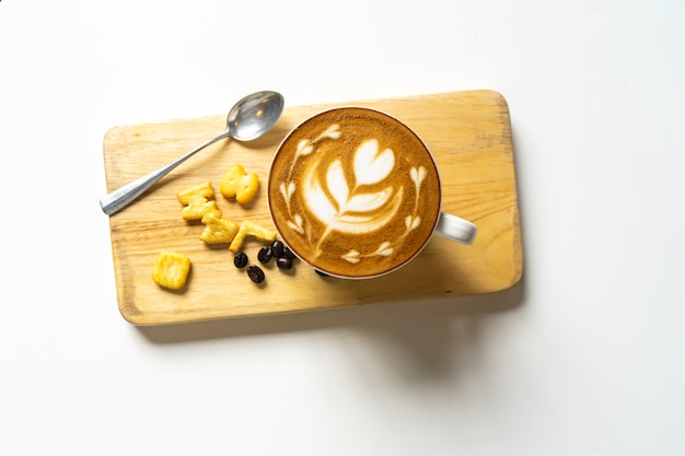 Top view of latte coffee or cappuccino coffee in white cup with beautiful tree heart latte art