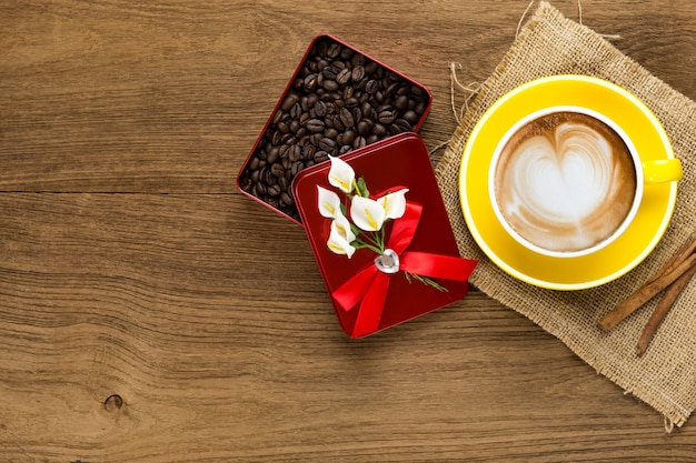 Top view of latte coffee or cappuccino with coffee beans in red box
