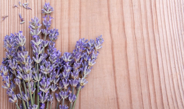 Top view lavender flowers on wood with copy space