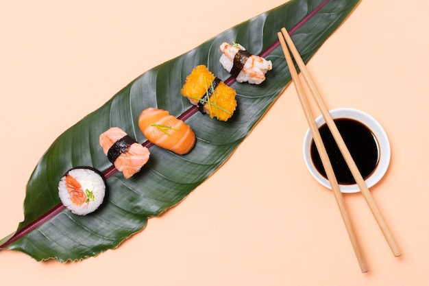 Top view leaf with sushi assortments