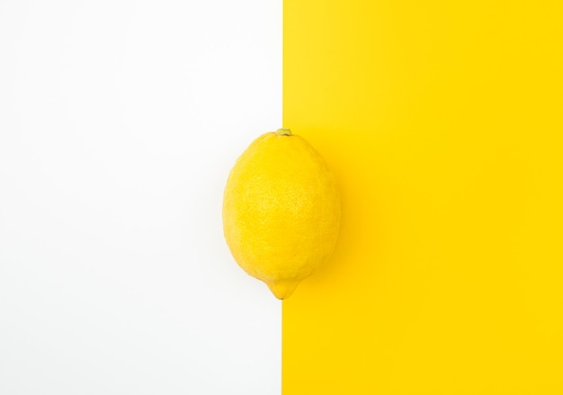 Top view of lemon on color background.