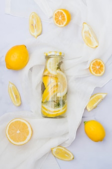 Top view lemonade surrounded by lemons