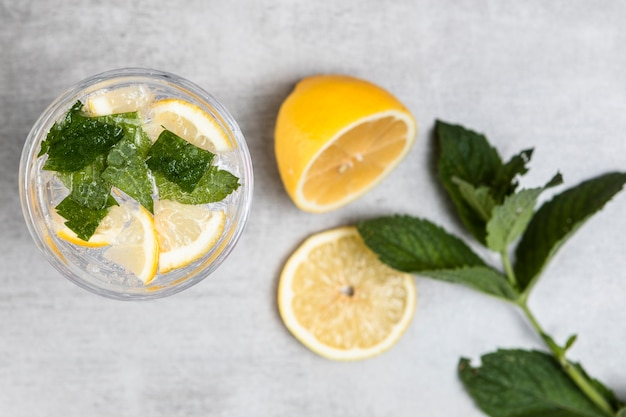 Top view of lemonade on wooden background