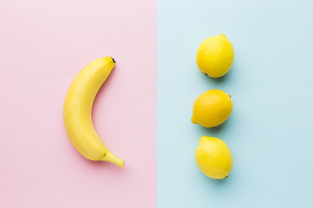 Top view of lemons and banana with copy space