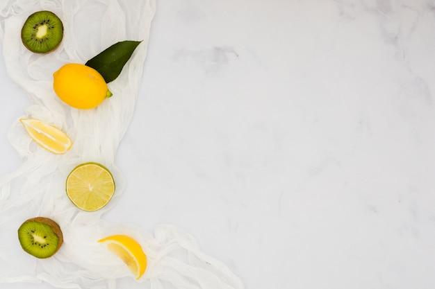 Top view lemons and kiwis