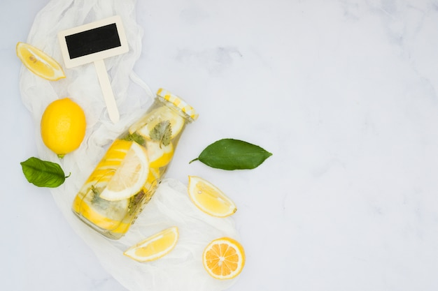 Top view lemons and lemonade