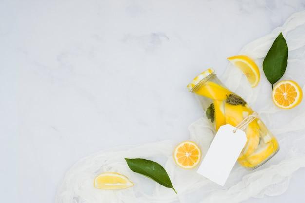 Top view lemons with lemonade