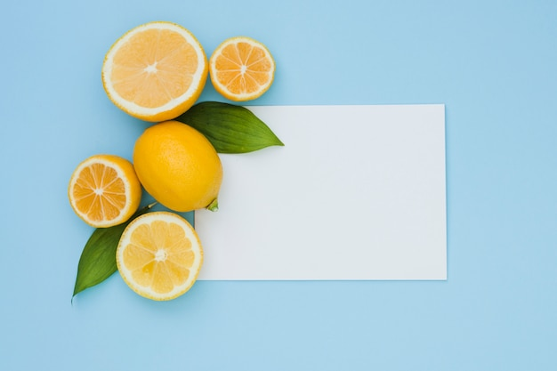 Top view lemons with paper