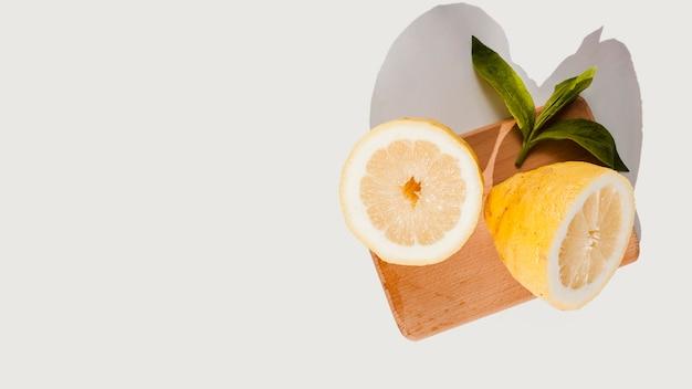 Top view lemons on wooden board