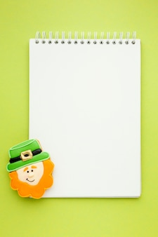 Top view leprechaun and notebook