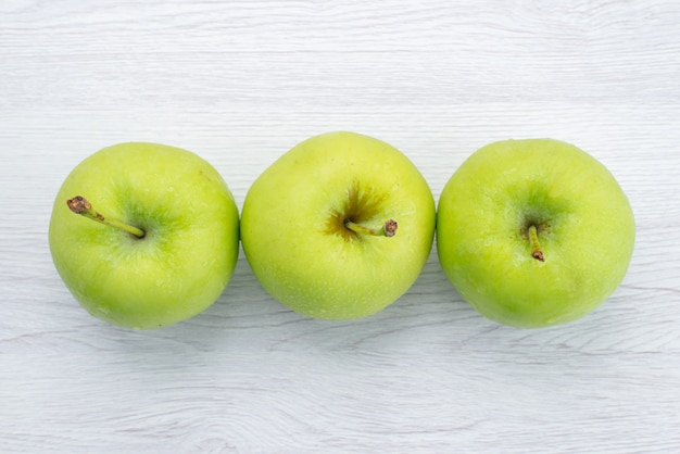 Top view lined green apples on the white background fruit mellow juice photo