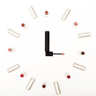 Top view lipsticks simulating clock