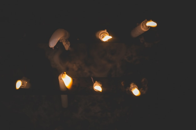 Top view of lit candles melting