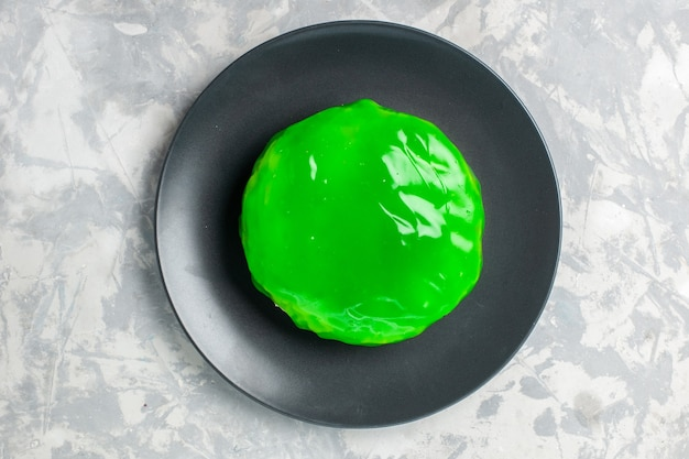 Top view little cake with green icing on white surface cake pie biscuit sweet sugar cookie