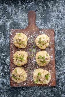 Top view little raw dumplings on light gray surface meat cuisine meal dough dish cake dinner