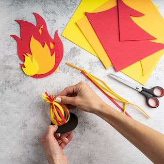 Top view of lohri day concept with fire paper design