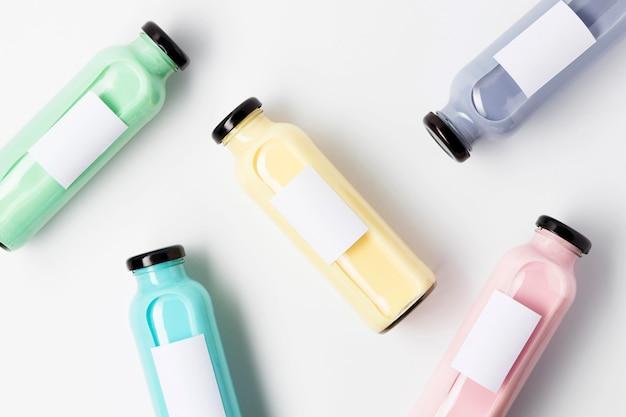 Top view of lots of multicolored fruit juice bottles
