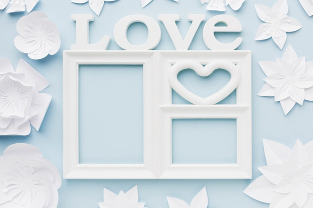 Top view love frame with paper flowers