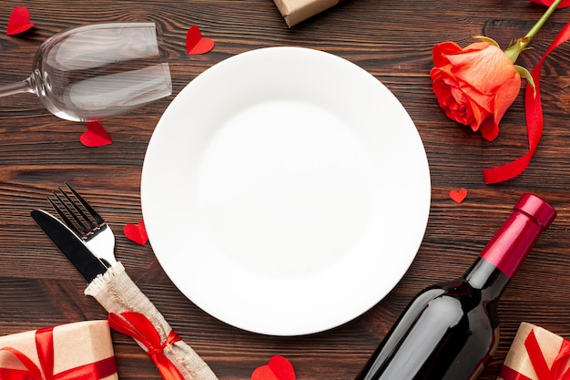Top view lovely arrangement for valentines day dinner on wooden background