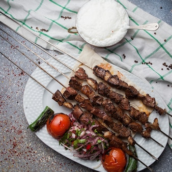Top view lule kebab with tomato and onion and ayran