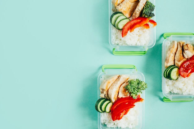 Top view of lunch boxes with food