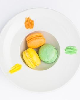 Top view macarons in deep plate