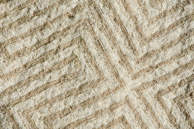 Top view macro of the beautiful pattern and texture of natural linen fabric.
