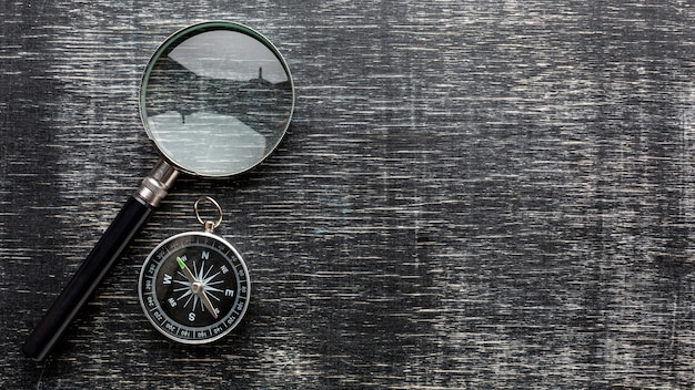 Top view magnifying glass and compass