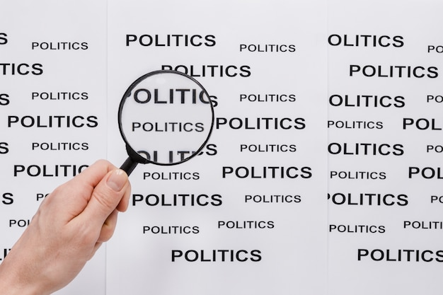 Top view of magnifying glass with politics