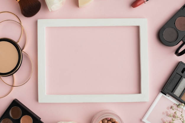 Top view make-up arrangement with white frame