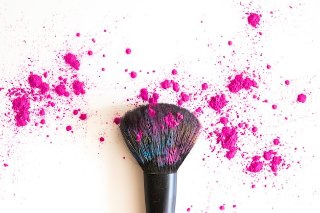 Top view of make up brush and pink face powder