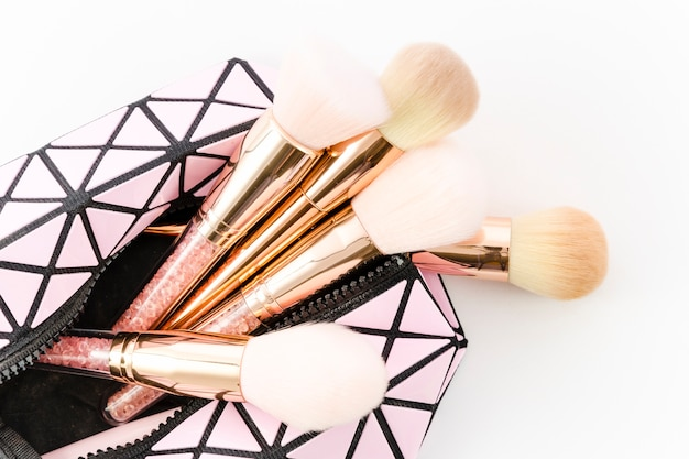 Top view make up brushes in toilet bag