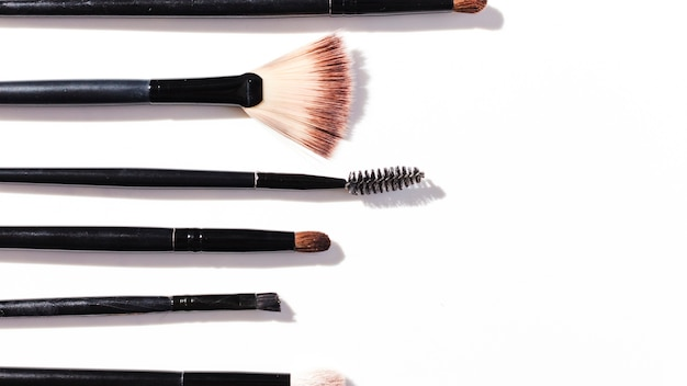 Top view make up brushes on white background