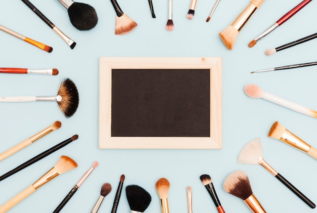 Top view make up brushes with blackboard