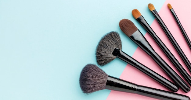 Top view make-up brushes with copy space