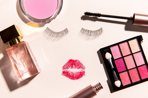 Top view of make up cosmetics on plain background