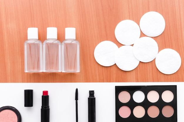Top view make up with bottle and cotton