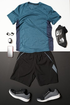 Top view of male running equipment on black and white background.healthy lifestyle concept