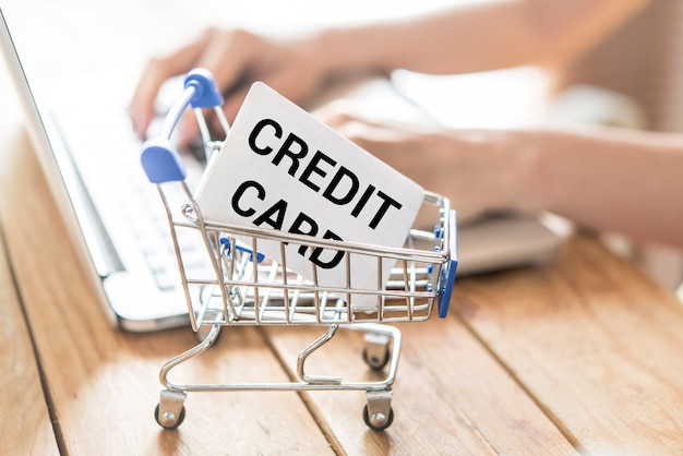Top view of man using credit card for online shoping