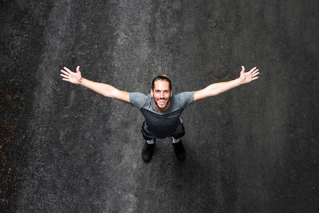 Top view of man with arms wide open