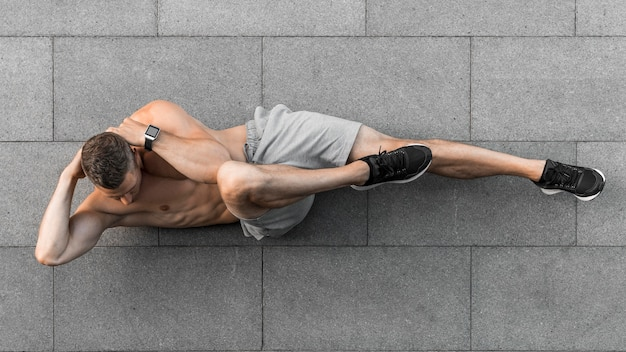 Top view man working out outdoors