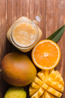 Top view mango and orange smoothie