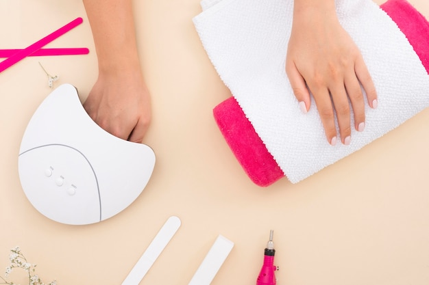Top view manicure process on beige background