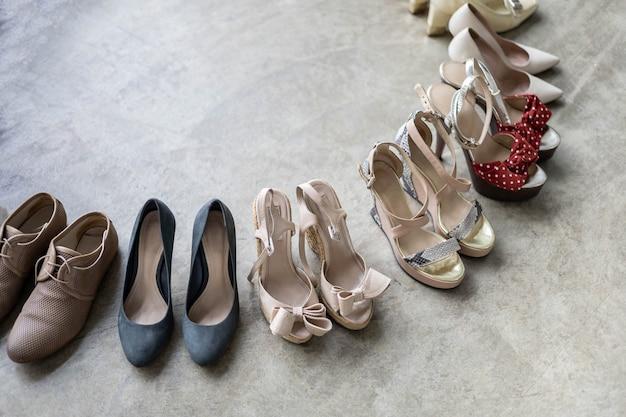 Top view many colored female shoes on gray floor footwear wheel fashion stylish footgear choosing