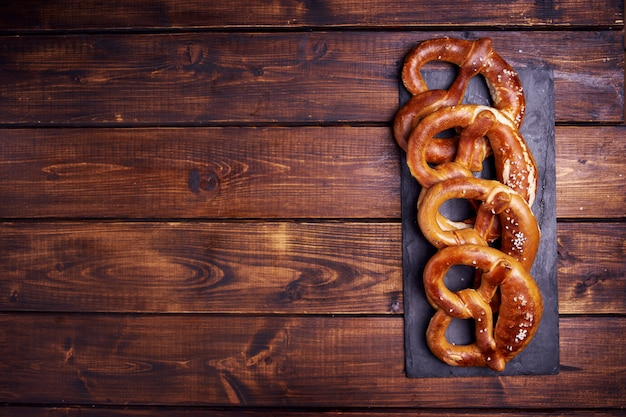 Top view of many pretzels on wooden background