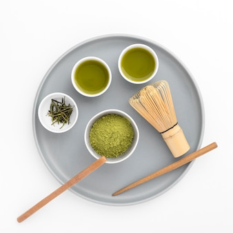 Top view matcha powder with bamboo whisk