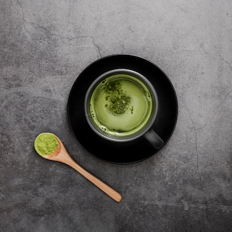 Top view of matcha tea in cup with spoon