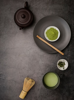 Top view of matcha tea essentials with copy space
