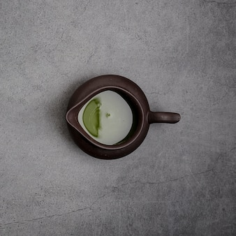 Top view of matcha tea in pourer