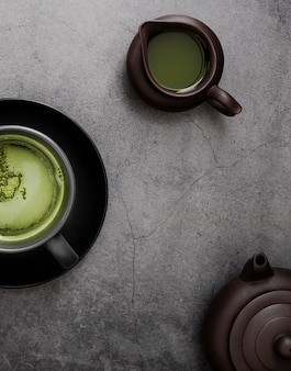 Top view of matcha tea with teapot